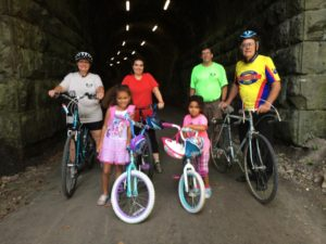 Riders at the newly-rehabbed and lighted V.A. Tunnel under Rt 98. Aug 2016. Photo credit: Diana Druga.